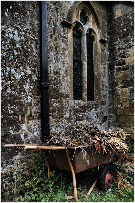 photoblog image Wheelbarrow behind a church